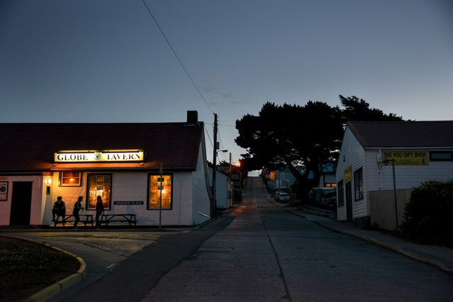 Just after sunset, patrons gather for food, fun, dancing and drinks at the Globe Tavern on Wednesday, February 10, 2016, in Stanley, Falkland Islands. (Photo by Jahi Chikwendiu/The Washington Post)