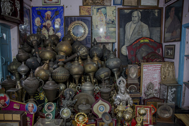 In this November 20, 2017 photo, photographs and trophies belonging to Indian Kushti wrestlers are seen inside the office of Guru Hunuman Akhada, one of India's oldest akhadas at Sabzi Mandi, in New Delhi, India. (Photo by Dar Yasin/AP Photo)