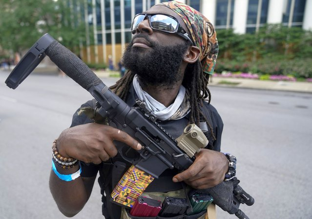 A supporter of an all-black militia group called NFAC is seen during a rally, in Louisville, Kentucky, U.S. July 25, 2020. A group of heavily armed Black protesters marched through Louisville, Kentucky demanding justice for Breonna Taylor, a Black woman killed in March by police officers who burst into her apartment. (Photo by Bryan Woolston/Reuters)