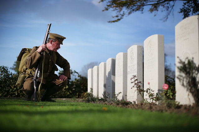 Living history enthusiast Chris Barker wears World War One period military uniform as he visits the Commonwealth War Graves Commission Y-Farm Cemetery on October 22, 2014 in Bois-Grenier, France. The remains of 15 Soldiers of the 2nd Battalion York and Lancaster Regiment of the British army, who were killed in the opening months of World War One on October 18, 1914 were discovered in 2009 during construction work near the French village of Beaucamps-Ligny. (Photo by Peter Macdiarmid/Getty Images)