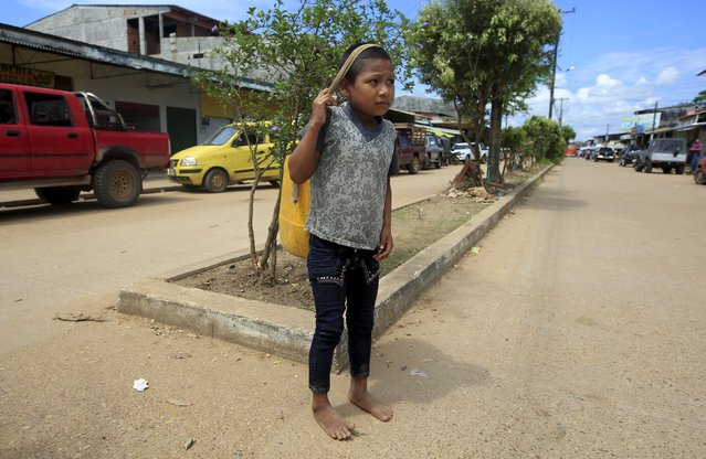 A Colombian Nukak Maku Indian boy is seen on the street in San Jose del Guaviare of Guaviare province, September 4, 2015. (Photo by John Vizcaino/Reuters)