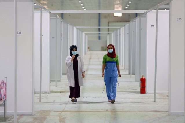 Health officials are seen in International Fair ground, which has been temporarily turned into a hospital in fighting against coronavirus (Covid-19) pandemic, for patients in Baghdad, Iraq on July 18, 2020. (Photo by Murtadha Al-Sudani/Anadolu Agency via Getty Images)