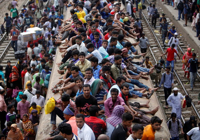 People sit atop an overcrowded passenger train as they travel home to celebrate the Eid al-Adha festival, at a railway station in Dhaka, Bangladesh, September 9, 2016. (Photo by Mohammad Ponir Hossain/Reuters)