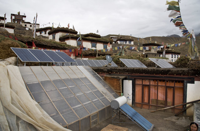 In this August 17, 2016, photo, solar panels are installed on the rooftop of a traditional house in the mountain village of Demul, Spiti Valley, India. Set up six years ago by an eco-tourism foundation, the panels provide 24/7 electricity to each household in the village. (Photo by Thomas Cytrynowicz/AP Photo)