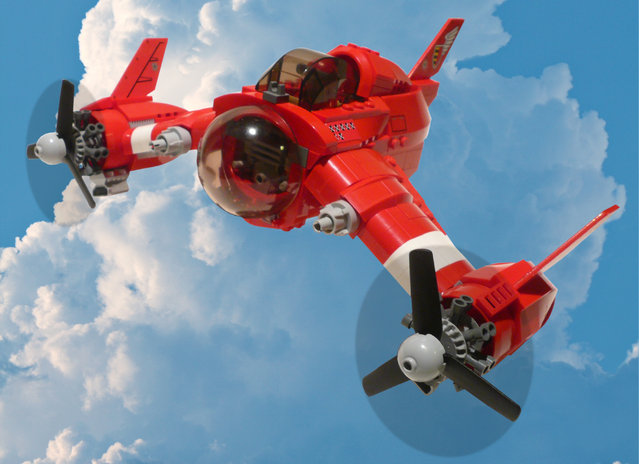 """""""Red Zephyr. I always meant to do this, but never got around to it (put in a background that is). Well, now I have – the Red Zephyr flies again!"""". (Jon Hall)"""