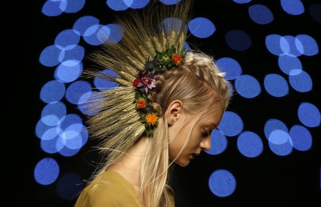 A model presents a creation from the Spring/Summer 2017 collection by Spanish designer Juanjo Oliva during the Mercedes Benz Fashion Week Madrid, MBFWM, in Madrid, Spain, 17 September 2016. The MBFWM runs from 15 to 20 September 2016. (Photo by J.J. Guillen/EPA)