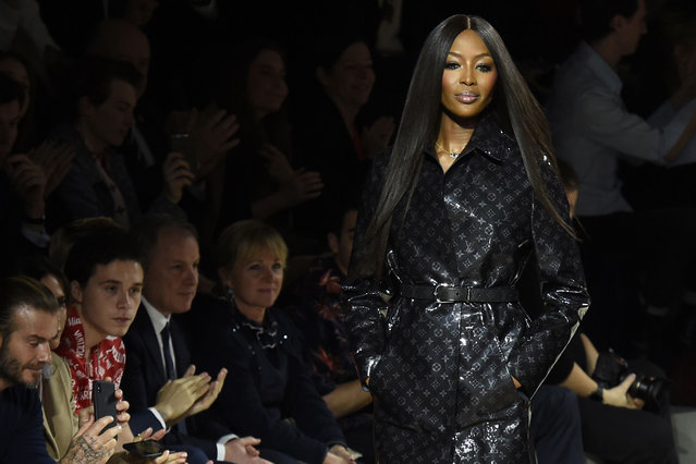 British model Naomi Campbell presents a creation for Louis Vuitton during the men' s Fashion Week for the Fall/ Winter 2018/2019 collection in Paris on Janaury 17, 2018. (Photo by Bertrand Guay/AFP Photo)