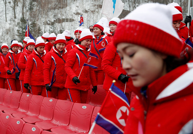 North Korean cheerleaders react as the start of the Alpine Skiing Women' s Slalom was delayed due to weather conditions at the Jeongseon Alpine Center during the Pyeongchang 2018 Winter Olympic Games in Pyeongchang on February 14, 2018. (Photo by Mike Segar/Reuters)