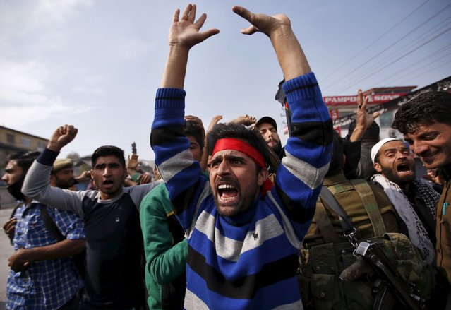 Kashmiri Shi'ite Muslim mourners shout slogans as they are stopped by Indian police during a Muharram procession ahead of Ashura in Srinagar October 22, 2015. Indian police in parts of Srinagar city on Thursday imposed restrictions by sealing off many residential areas to prevent Muharram processions, local media reported. Ashura, which falls on the 10th day of the Islamic month of Muharram, commemorates the death of Imam Hussein, grandson of Prophet Mohammad, who was killed in the 7th century battle of Kerbala. (Photo by Danish Ismail/Reuters)