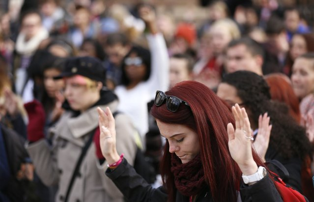 Students at the University of Colorado hold up their hands for 4 1/2 minutes in support of protesters in Ferguson Missouri, during a demonstration, which was part of a national student walk-out, in Boulder, Colorado December 1, 2014. (Photo by Rick Wilking/Reuters)