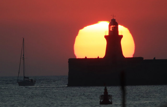 The rising sun over South Shields pier and lighthouse on the UK North East coast on September 2, 2020. (Photo by Owen Humphreys/PA Images via Getty Images)