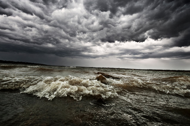 The waves and clouds reflect each other at Lake Lewisville, Lewisville, Texas on March 2013. (Photo by Mike Mezeul II/Caters News)