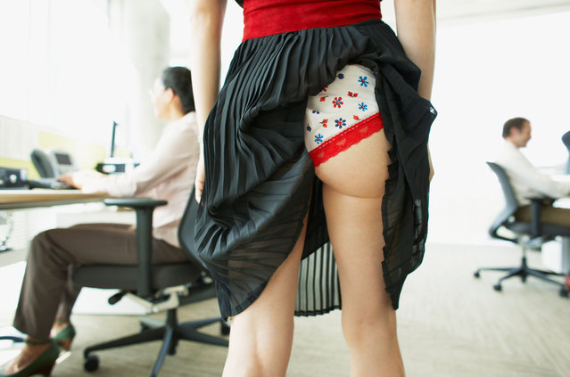 Businesswoman with skirt caught in underwear. Image shot 2008, exact date unknown. (Photo by Alamy Stock Photo)