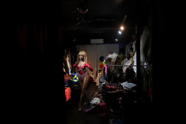 Transgender drag queen Aunchalee Pokinwuttipob, better known by the stage name, Angele Anang, 26, gets ready for her show at The Stranger bar in Silom district in Bangkok, Thailand, September 18, 2020. (Photo by Chalinee Thirasupa/Reuters)