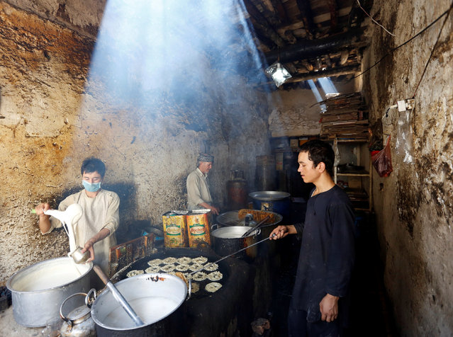 Afghan men make sweets at a small traditional factory ahead of the Eid al-Adha festival, in Kabul, Afghanistan September 10, 2016. (Photo by Mohammad Ismail/Reuters)