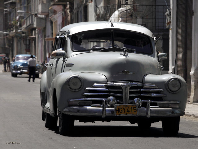 A 1947 Chevrolet car drives along a street in Havana, April 13, 2010. (Photo by Enrique De La Osa/Reuters)