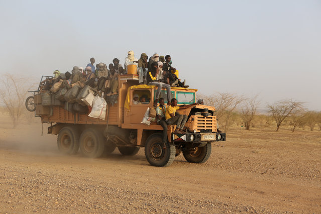 A truck carrying gold miners across the Sahara desert to far northern Niger drives outside Agadez, Niger, May 9, 2016. (Photo by Joe Penney/Reuters)