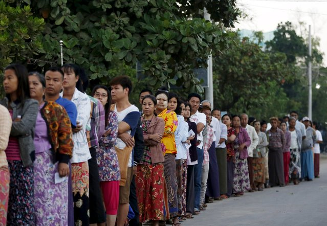 People queue up to vote during the general election in Mandalay, Myanmar, November 8, 2015. (Photo by Olivia Harris/Reuters)