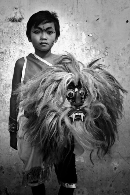 """""""My work is about a traditional dance from Indonesia. This dance called Jaranan. I chose Jaranan because this dance usually played by adult, so it looks unusual. That boy played as Pentulan"""". (Photo by Diko Risanto/2013 Sony World Photography Awards)"""