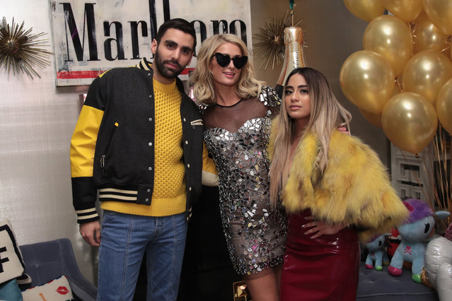 (L-R) Phillip Picardi, Paris Hilton, and Ally Brooke attend the Paris Hilton X Beautycon Festival NYC Pre-Party on April 20, 2018 in New York City. (Photo by Cindy Ord/Getty Images for Beautycon)