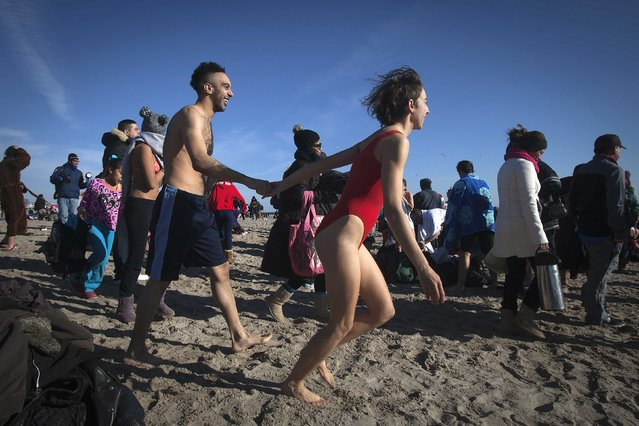 People take part in the Polar Bear Plunge on Coney Island in the Brooklyn borough of New York January 1, 2015. (Photo by Carlo Allegri/Reuters)
