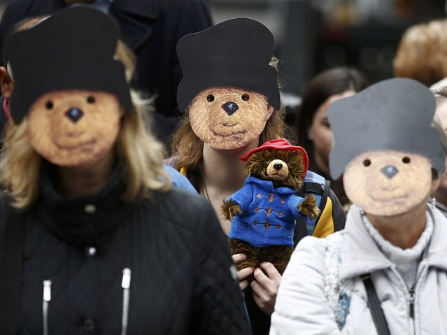 Demonstrators wear Paddington Bear masks during a protest highlighting the plight of child refugees, outside the Home Office in London, Britain October 24, 2016. (Photo by Peter Nicholls/Reuters)