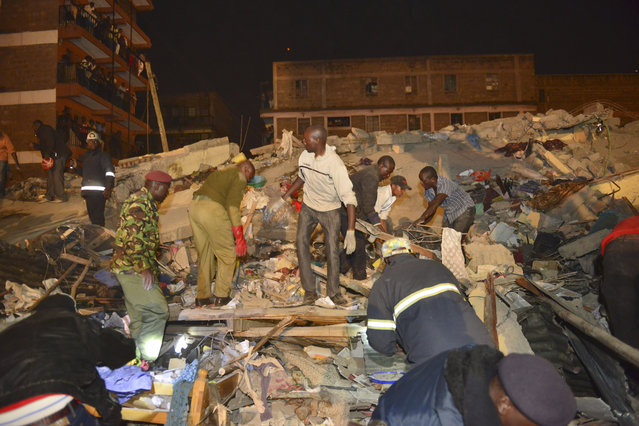 Rescue workers search for survivors of  a multi-storey building collapse in the capital Nairobi, Kenya Sunday, January 4, 2015. (Photo by AP Photo)