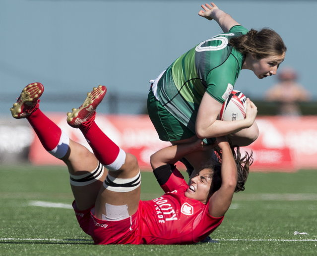 Canada's Bianca Farella, bottom, tries to tackle Ireland's Eve Higgins during the World Rugby Women's Sevens Series in Langford, British Columbia, Saturday, May, 12, 2018. (Photo by Jonathan Hayward/The Canadian Press via AP Photo)