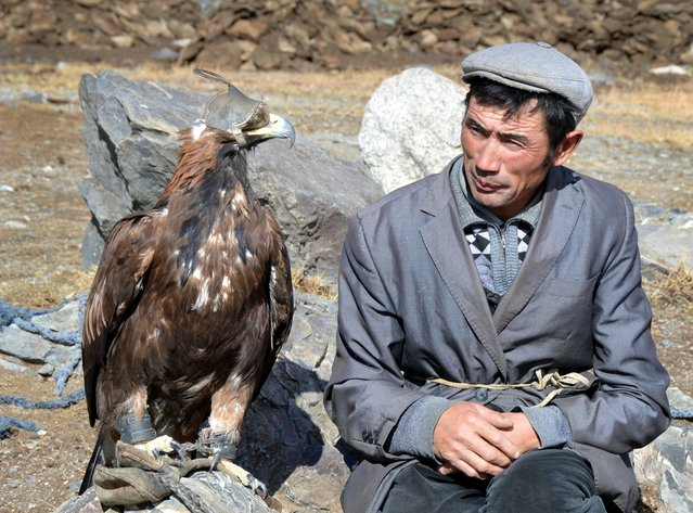 Hunter Berek and his eagle outside his home. (Photo by Brad Ruoho/The Star Tribune)