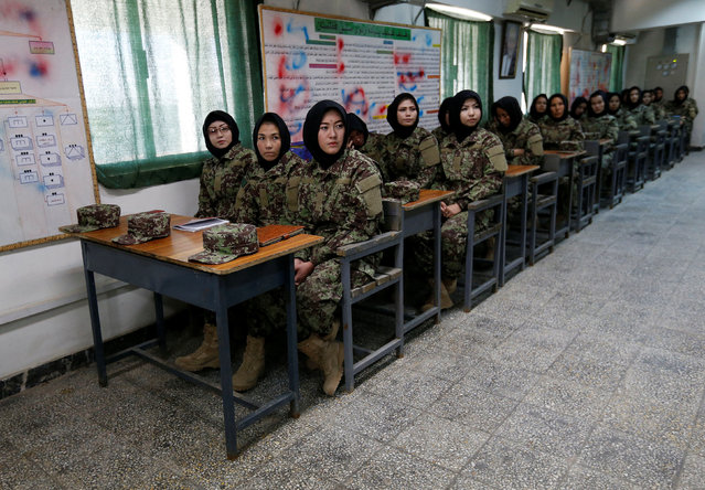 Female soldiers from the Afghan National Army (ANA) attend a lesson in a classroom at the Kabul Military Training Centre (KMTC) in Kabul, Afghanistan October 23, 2016. (Photo by Mohammad Ismail/Reuters)