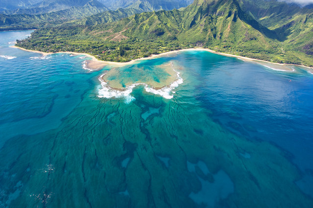 """Tunnels Beach"". The protective coral reef that makes Tunnels Beach a great place for beginners to snorkel & scuba dive can be seen from the air. The beach is located on the island of Kaua'i, Hawai'i. (Photo and caption by Scott Chapman/National Geographic Traveler Photo Contest)"