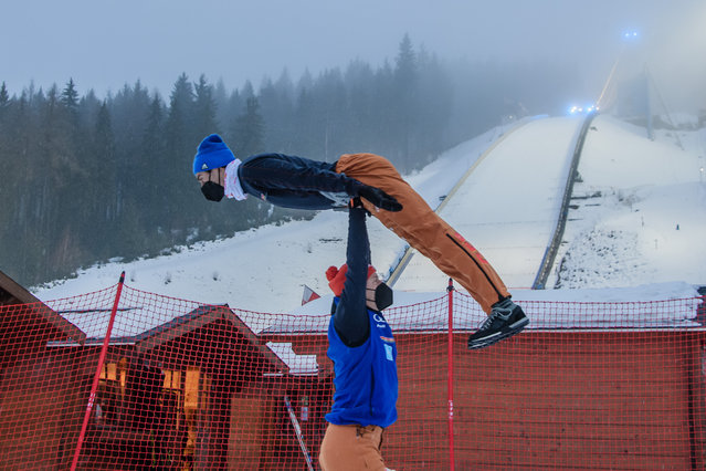 Athletes warm up at the FIS World Cup Nordic Combined event in Klingenthal, Germany, 06 February 2021. (Photo by Clemens Bilan/EPA/EFE)