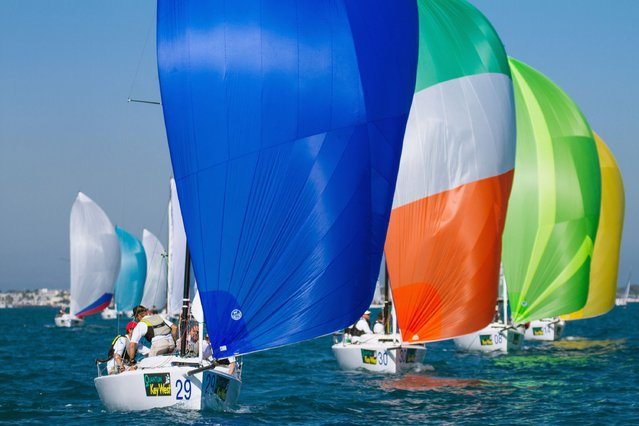 J/70s sailboats navigate under spinnakers during the third day of racing at the Quantum Key West regatta off Key West, Florida January 21, 2015. With 54 entries, the J/70 class is the largest of the 10-class fleet that has attracted 115 sailing vessels to the Florida Keys. The five-day regatta is to continue through Friday, January 23, 2015. (Photo by Ken Stanek/Reuters/Florida Keys News Bureau)