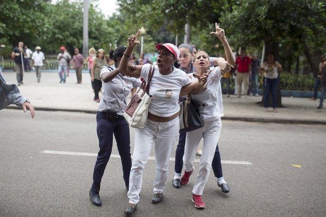 Cuban security personnel detain members of the Ladies in White dissident group during a protest on International Human Rights Day, Havana, December 10, 2015. (Photo by Alexandre Meneghini/Reuters)