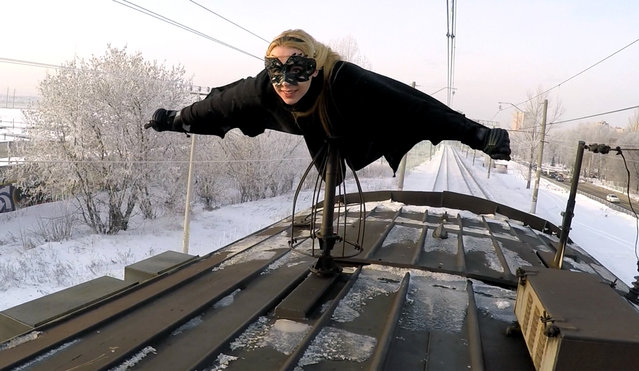 Rush-hour in Russia means one thing for this daredevil: train surfing! The 19-year-old daredevil who goes by the name Kobzarro started train surfing aged 15 as a way of escaping an oppressive family life. Here Kobzarro can be seen balanced on top of a train as it speeds through the wintery Russian environment. Kobzarro is so dedicated to train surfing that she rarely gets inside a train. Even in winter she prefers to travel in this less conventional way. It has resulted in a few run ins with the law, but Kobzarro says it has never resulted in anything more serious than a fine, with many police officers even being interested in the train surfing community. (Photo by Caters News Agency)