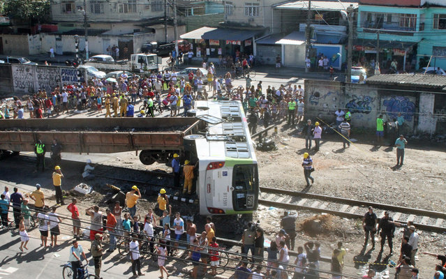 A freight train and a bus collided in the north of Rio de Janeiro, on the morning of Friday, July 5, 2013. (Photo by Jadson Marques)