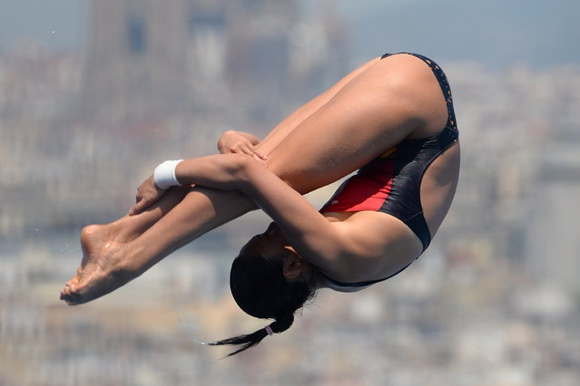 China's Wang Han competes in the women's 1-metre springboard final diving event in the FINA World Championships at the Piscina Municipal de Montjuic in Barcelona on July 23, 2013. (Photo by Josep Lago/AFP Photo)