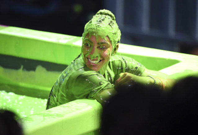 WNBA basketball player Candace Parker of the Los Angeles Sparks is slimed following the slime dunk challenge at the Kids' Choice Sports Awards at the Barker Hangar on Thursday, July 19, 2018, in Santa Monica, Calif. (Photo by Phil McCarten/Invision/AP Photo)
