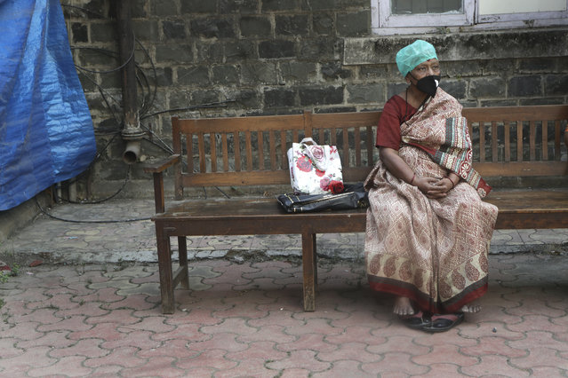 An elderly Indian woman waits for her turn to receive COVID-19 vaccine in Mumbai, India, Wednesday, March 10, 2021. (Photo by Rajanish Kakade/AP Photo)