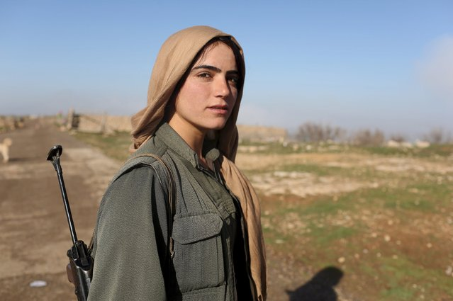 A female Kurdistan Workers Party (PKK) fighter stands near a security position in Sinjar, Iraq March 13, 2015. (Photo by Asmaa Waguih/Reuters)