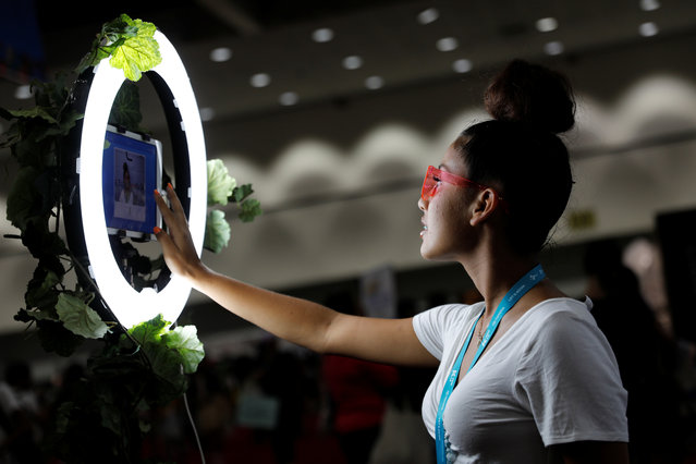 An attendee takes a selfie at KCON USA, billed as the world's largest Korean culture convention and music festival, in Los Angeles, California on August 11, 2018. K-pop acts sing or rap in Korean, often with snippets of English. On the Web, where K-pop fandom thrives, many music videos include subtitles. (Photo by Mike Blake/Reuters)