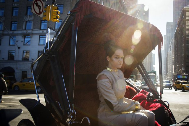 A model wearing a creation from fashion designer Viktor Luna rides on a horse carriage along 59th St in New York February 11, 2015. (Photo by Lucas Jackson/Reuters)
