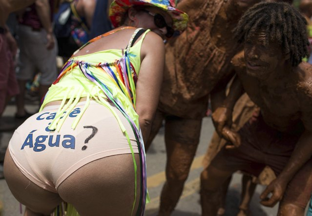 """Revellers take part in an annual carnival block party known as """"Juca Teles"""" in Sao Luiz do Paraitinga February 14, 2015. The underwear reads """"Where is the water?"""" in protest against the drought in Brazil. (Photo by Roosevelt Cassio/Reuters)"""