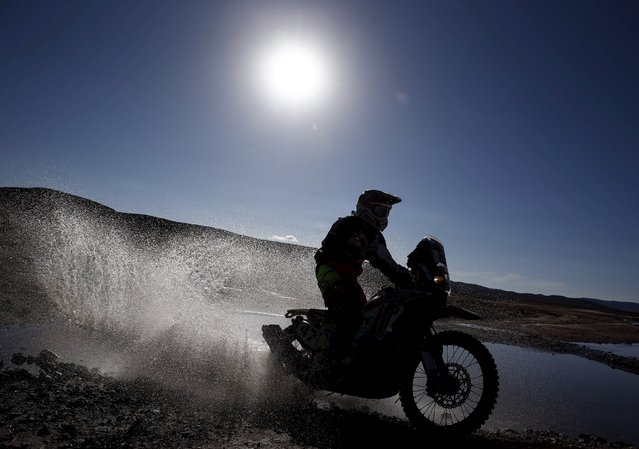 Kevin Benavides of Argentina rides his Honda during the seventh stage in the Dakar Rally 2016 near Uyuni, Bolivia, January 9, 2016. (Photo by Marcos Brindicci/Reuters)