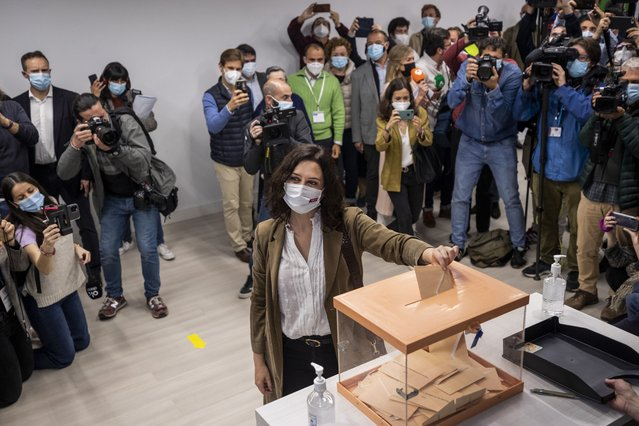 The incumbent conservative Madrid president Isabel Diaz Ayuso casts her vote during the regional election in Madrid, Spain, Tuesday, May 4, 2021. (Photo by ernat Armangue/AP Photo)