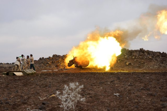 Mujahideen Horan brigade fighters, part of the Free Syrian Army, react as they launch a shell towards forces loyal to Syria's President Bashar al-Assad located in Deraa, Syria, in what they said was a battle to pressure breaking the siege off Madaya, January 11, 2016. (Photo by Alaa Al-Faqir/Reuters)