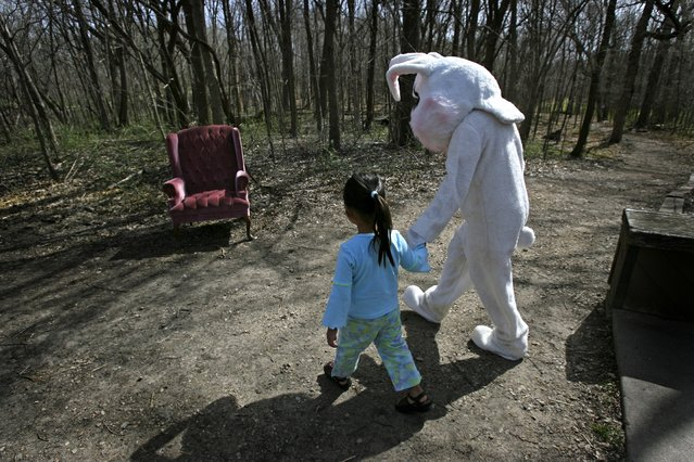 Four-year-old Mya Lillemoen, gives the Easter Bunny a hand to his chair before a small hike at the Eastman Nature Center during the center's Easter activities, Friday, April 14, 2006. Lillemoen was there with her mother Masha Lillemoen of Maple Grove. Children enjoyed a hike, hunting eggs, dying eggs, face painting, arts and crafts, and a visit with real bunnies. (Photo by Elizabeth Flores/Star Tribune)
