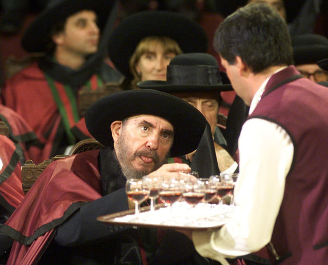 Cuban President takes a glass during a ceremony in the Oporto Bourse where he and other Ibero-American leaders were made members of the Port Wine Brotherhood in Portugal, October 1998. (Photo by Desmond Boylan/Reuters)