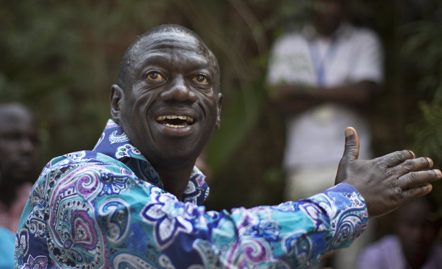 Opposition leader Kizza Besigye speaks to the media at his residence in the town of Kasangati, outside Kampala in Uganda Tuesday, February 16, 2016. Besigye, who is in a close race with long-time President Yoweri Museveni, said Tuesday he does not believe the election will be free and fair. (Photo by Ben Curtis/AP Photo)