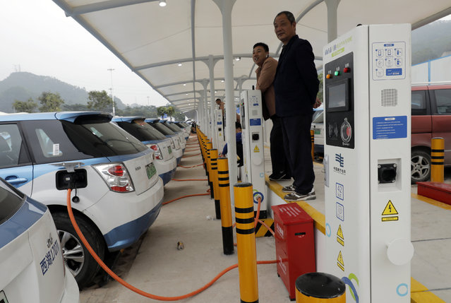 In this Monday, January 7, 2019, photo, new electric-powered taxis are charged at a public charging station in Shenzhen city, south China's Guangdong province. One of China's major cities has reached an environmental milestone, an almost all electric-powered taxi fleet. The high-tech hub of Shenzhen in southern China announced at the start of this year that 99 percent of the 21,689 taxis operating in the city were electric. (Photo by Vincent Yu/AP Photo)